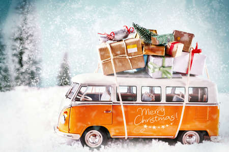 The Xmas bus in winter season, with many snowflakes driving in snowy landscape. For christmas invitation.