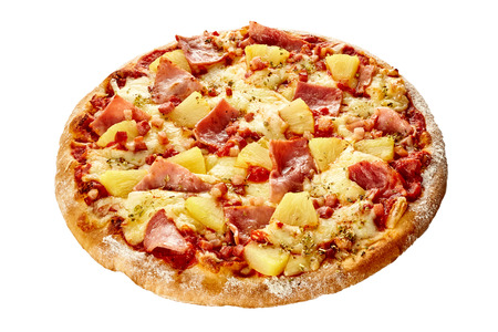 Delicious Hawaiian pizza with ham and pineapple on a thick pastry crust flame grilled in a pizzeria isolated on white Stock Photo