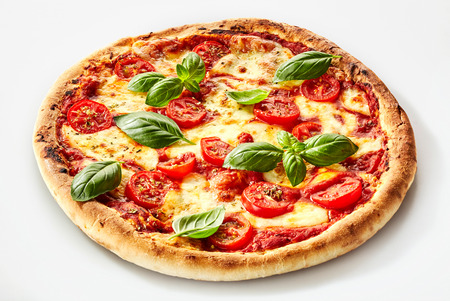 Flame grilled Margherita Italian pizza with fresh basil leaves on a thick biscuit base with mozzarella cheese and tomato