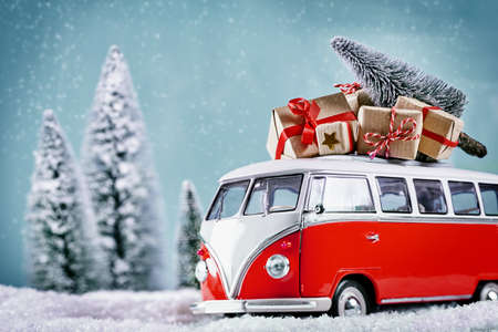 vintage car: Christmas Bus with xmas gifts on the way to the party Stock Photo
