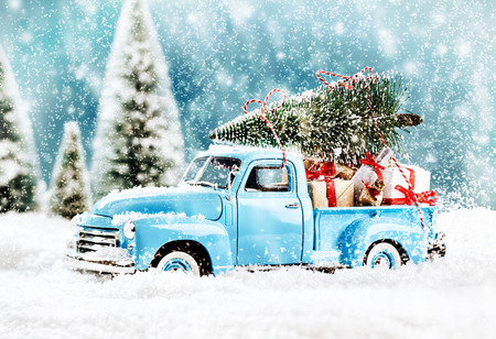 Merry Christmas tree transporter bringing gifts to all the sweethearts on x mas evening Stock Photo