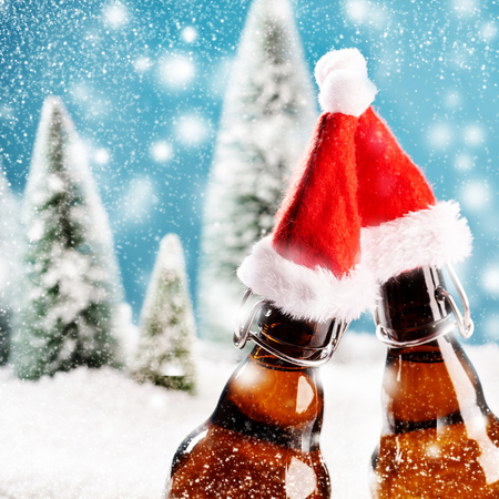 Two xmas beer bottles clink together. A card for christmas party invitation in square format with snow white background