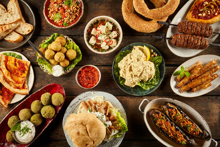 Top down view on enormous buffet of delicious freshly prepared middle eastern cuisine