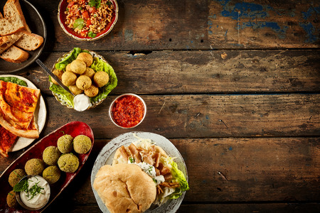 Middle eastern falafel and dip on table with copy space over dark wooden surface