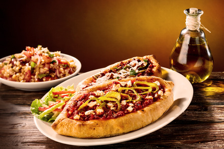 turkish bread: Two turkish style pizza made with meat sauce and served with olive oil and rice bowl