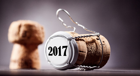 Selective focus cork and metal bottle cap close up with numbers 2017 on top end section