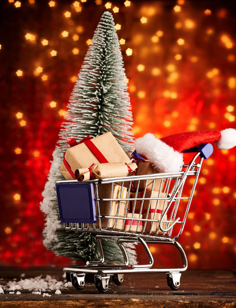 Shopping cart for x mas season with cute little christmas hats and x-mas tree