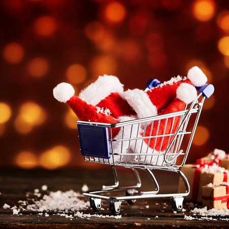 christmas hats: Xmas shopping caddy or cart with christmas hats or caps