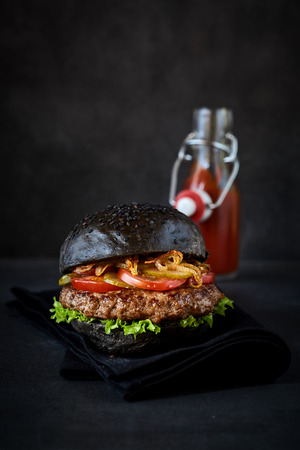 freshly prepared: Tasty freshly prepared black sandwich with ketchup bottle in background. Includes copy space.