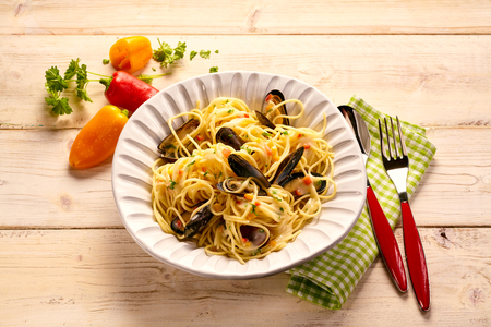 Serving size of pasta with mussels tabletop photography Stock Photo