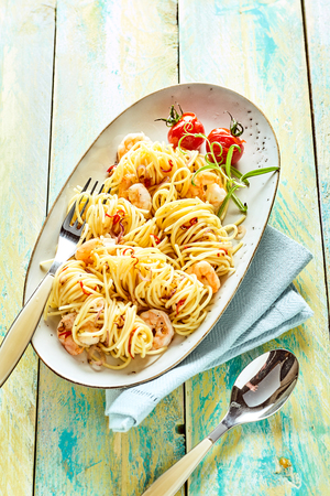 scampi: Overhead view of spaghetti with fresh scampi
