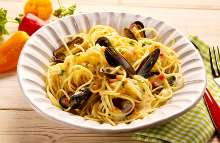 Plate full of pasta with steamed mussels. Stock Photo