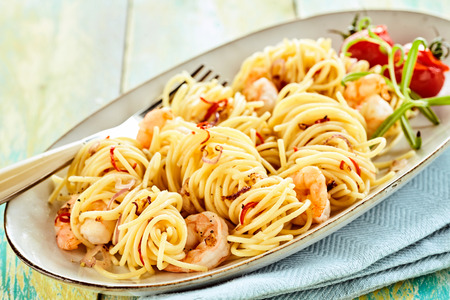 scampi: Tasty traditional italian pasta with scampi in an unique bowl for italy food concepts
