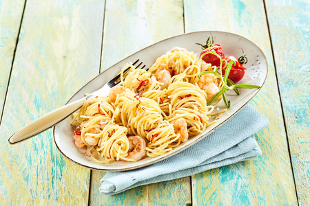 scampi: Big bowl of italy spaghetti with seafood scampi on a nice modern table