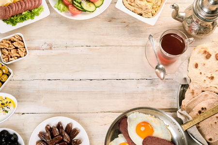 carnes y verduras: Border of oriental breakfast on white wood background in overhead view. Foto de archivo