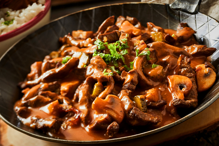 Close up of a pan of beef stroganoff goulash with mushrooms and pickled mushrooms Stock Photo