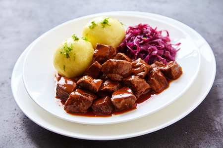 cubed: Single serving of braised purple cabbage beside juicy beef stew and potato