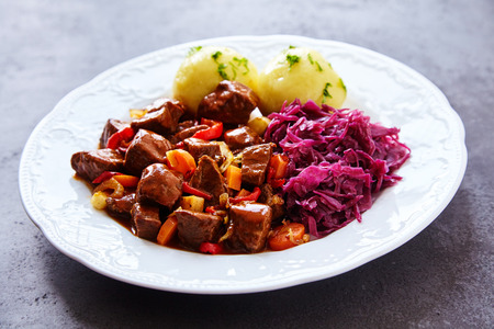 Savory Hungarian platter comprised of cabbage, potato dumplings and spicy beef and vegetables Stock Photo