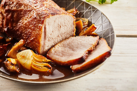 natural juices: Delicious home cooked German roast veal with onions and mushrooms served in an old pan in the natural juices from the meat and vegetables Stock Photo