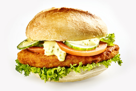 Burger with schnitzel fried meat and vegetables, close-up isolated on white background Stock Photo