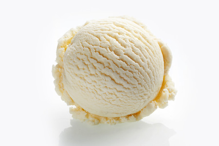 Scoop of vanilla ice cream close-up isolated on white background Imagens