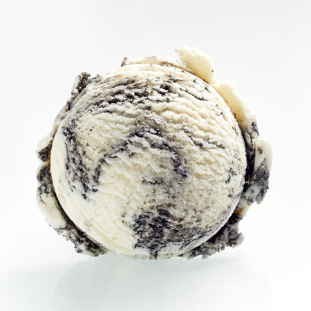 Scoop of speciality American biscuit ice cream made with crumbled cookies viewed from above to show the texture over a white background