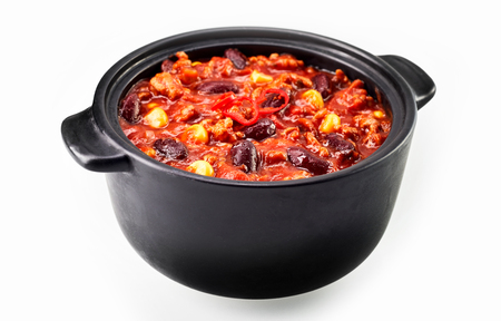 Chili con carne stew in black iron pan isolated on white background