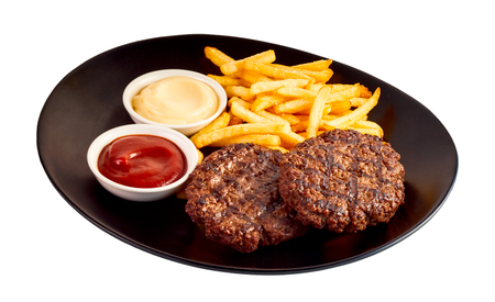 stakes: Minced meat burger stakes with french-fries and sauces on black dish isolated on white background Stock Photo
