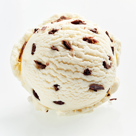 Speciality Italian stracciatella ice cream scoop with flakes of dark chocolate in a creamy vanilla ice-cream viewed from above showing the texture