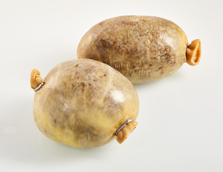 neeps: Two small Scottish haggis or sheep stomachs stuffed with the lungs, liver, heart, oatmeal, onion, suet and seasonings Stock Photo