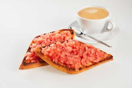 Two portions of crispy fried tostada topped with fresh salsa served with a cup of coffee or tea for a tasty snack