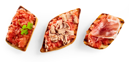 Advertising banner with three different crunchy deep fried tostrada tortillas topped with fresh salsa, tuna and prosciutto ham isolated on white from above 版權商用圖片