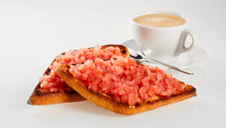 Crispy deep fried tortilla or tostrada topped with salsa and served with coffee for a regional Tex-mex snack or appetizer