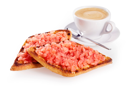 Deep fried crispy tostada or tortilla topped with salsa and served with a cup of coffee on a white background with copy space for advertising or a menu