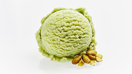 Single Scoop of Green Pistachio Ice Cream and Shelled Pistachio Nuts on White Background - Silhouette Cut Out Still Life