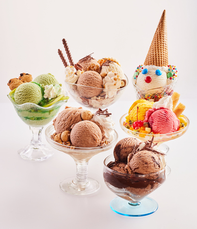 deliciously: Assortment of five deliciously sweet ice cream desserts with various toppings in custom made glass sundae bowls