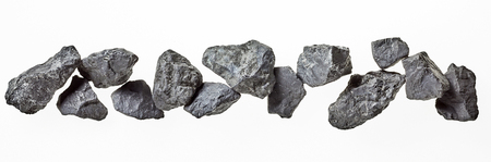 energy healing: Banner of natural Russian shungite stones isolated on white used in alternative medicine to purify and energise water due to its high carbon content and metaphysical properties