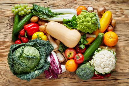 Rectangle pile of fresh vegetables and fruits on wooden table, studio shot for healthy diet background concept Banco de Imagens