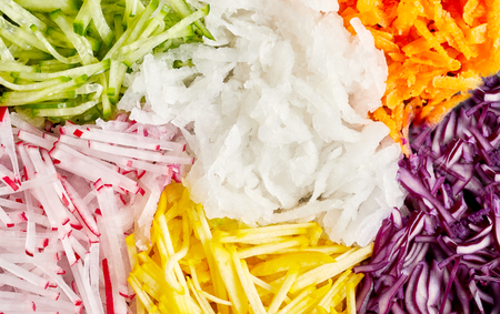 Grated vegetables as healthy food ingredients for cooking in full frame close-up background concept Imagens