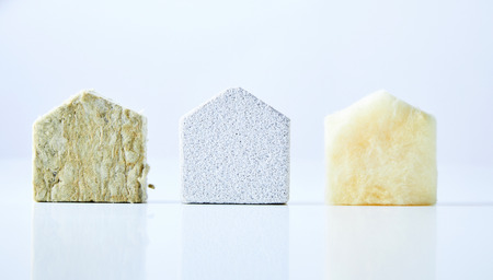 Three natural coloured, textured house shapes isolated on a white background Stock Photo