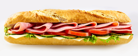 Tasty fresh baguette sandwich with baked ham, tomato, cheese and lettuce on a crusty roll over a white background for advertising in a panorama banner format Stock Photo