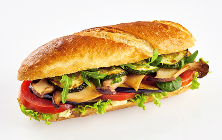 Fresh baguette vegetable sandwich with zucchini, eggplant, tomato and salad