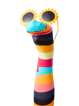 Colorful striped sock puppet with sunglasses isolated on white background