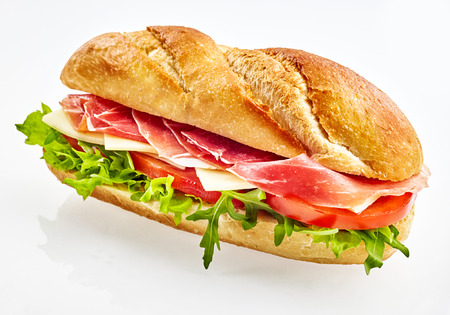 Fresh baguette sandwich with serrano ham , cheese, tomato and salad