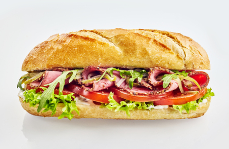 Baguette sandwich with roast beef, tomato and mixed salad
