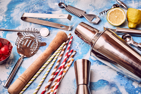 Cocktail Bar utensils scattered on abstract blue dappled background Banco de Imagens
