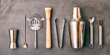 Set of Cocktail Bar utensils and vessels arranged in row