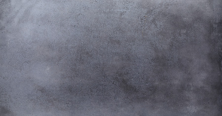 A rustic dark empty blackboard background in a panoramic aspect ratio.