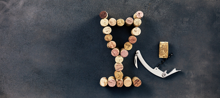 Wine corks arranged in shape of glass with corkscrew