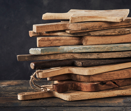Still life with stack of wooden cutting boards